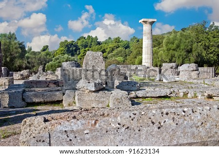 Ancient ruins of the Philippeion at Olympia, Greece. The Temple of Zeus at Olympia. Site of the ancient Olympic Games is situated on the Peloponnese. UNESCO world heritage site. - stock photo