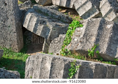 Ancient ruins of the Temple of Zeus at Olympia, Greece. Detailed view of broken column. Site of the ancient Olympic Games is situated on the Peloponnese. UNESCO world heritage site. - stock photo