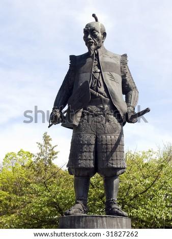 Ancient samurai statue - stock photo