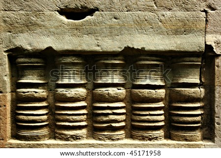 Ancient Sandstone Carving at ancient Cambodia Ruins - stock photo