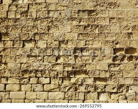 Ancient sandstone wall texture of Fort Saint Angelo, Malta - stock photo