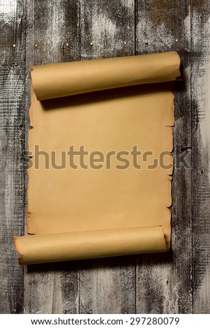 Ancient scroll rolled in wooden Background with Empty Space for Text - stock photo