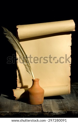 Ancient scroll rolled in wooden Background with Quill Pen - stock photo