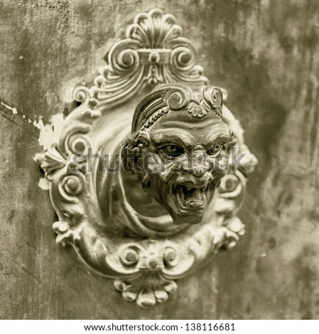 Ancient sculpture of a man's head on the wall of a Venetian home - Venice, Italy (stylized retro)