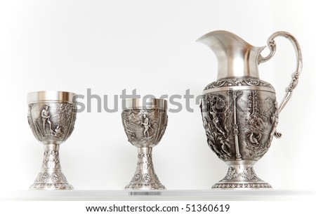 Ancient silver tableware. Jug and two cups - stock photo