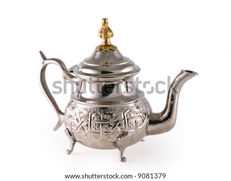 Ancient silver teapot on a white background