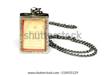 ancient small buddha thai style amulet - stock photo