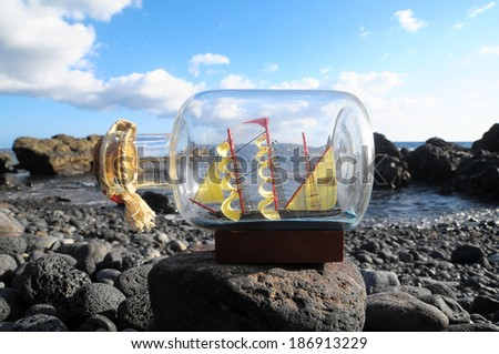 Ancient Spanish Sailing Boat in a Bottle near the Ocean