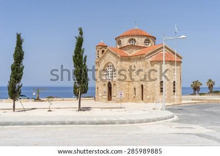 Ancient St. George church (Agios Georgios) on blue sky background. Cape Drepano, Cyprus.  - stock photo