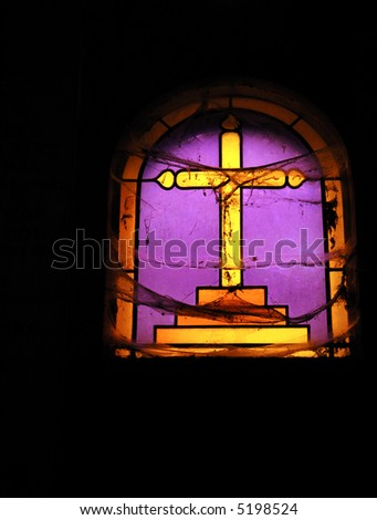 Ancient Stained glass covered by Spider webs , dark spooky ambience - stock photo