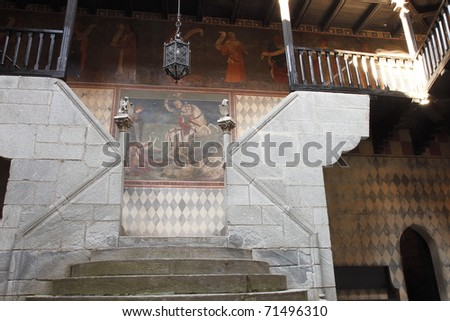 ancient staircase with frescoes on the wall turin Italy - stock photo