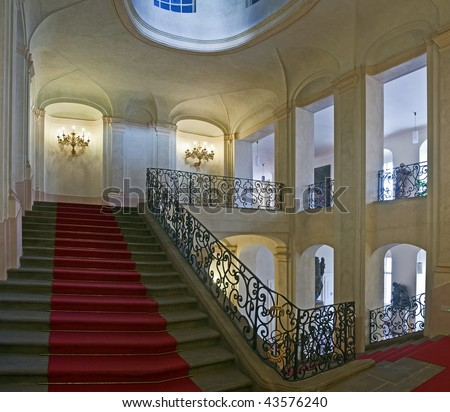 ancient staircase with red carpet - stock photo