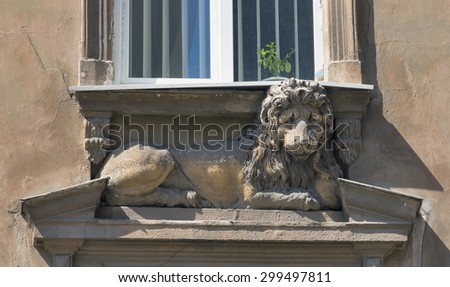 ancient statue of a lying lion under the house window in Lviv, Ukraine