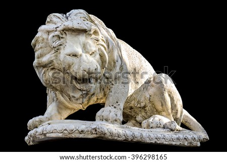 Ancient statue of a reclining lion isolated on black