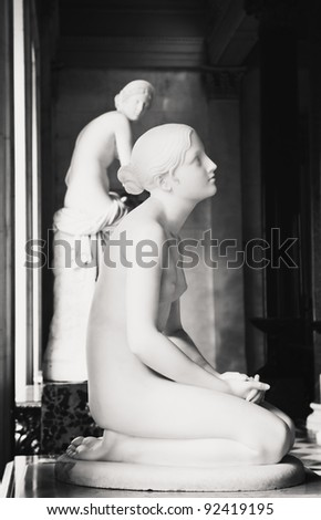 Ancient Statue of a Young Naked Girl - stock photo