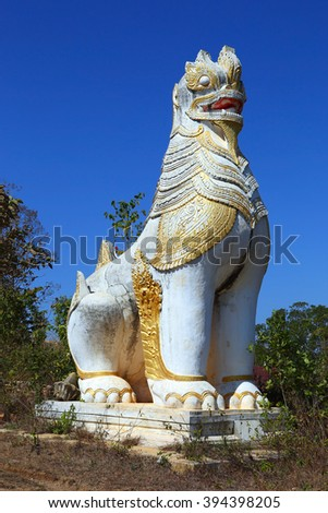 Ancient statue of lion guardian in Shwe Inn Thein Paya temple complex near Inle Lake in central Myanmar (Burma) - stock photo