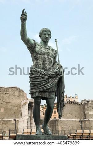 Ancient statue S.P.Q.R. IMP CAESAR Augustus PATRIAE PATER. Via dei Fori Imperiali street, Rome, Italy - stock photo
