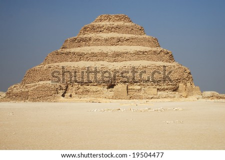 Ancient step pyramid of Djoser (Zoser) at Saqqara plateau, Egypt, near Cairo - stock photo