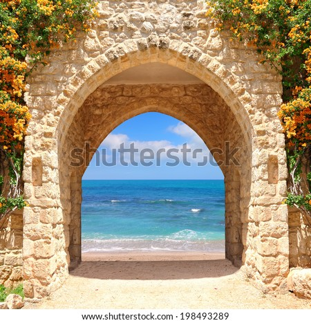 Ancient stone arch to the sea  - stock photo