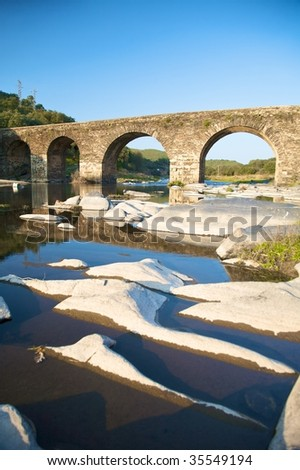 ancient stone bridge on a river in salamanca spain