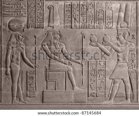 ancient stone relief at Chnum temple in Egypt - stock photo