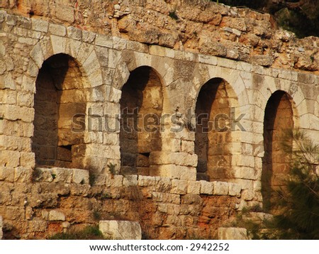 Ancient stone ruins of hellenic culture in Athens - stock photo