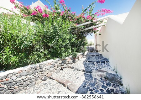 Ancient stone stairs and narrow street on Santorini island. - stock photo