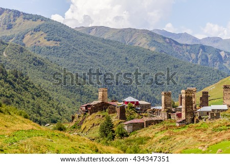 ancient stone tower in Georgia, mountain background
