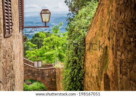 Ancient street in a small town in Tuscany - stock photo