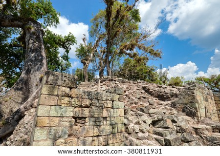 Ancient structures and carving of West Court at Copan archaeological site of Maya civilization in Honduras - stock photo