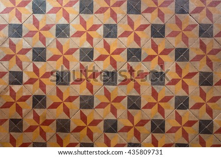 Ancient style with seamless pattern floor tiles with red black and orange colors. - stock photo