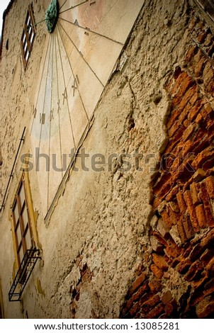 ancient sundial on the yellow stucco wall in Zagreb, Croatia - stock photo