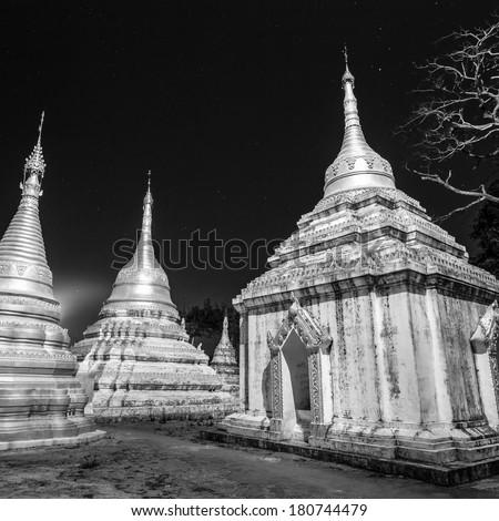 Ancient tample close to Pindaya Cave located next to the town of Pindaya, Shan State, Burma (Myanmar). Famous buddhist pilgrimage site and a tourist attraction shot at night. - stock photo