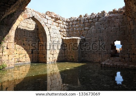 Ancient tank for collecting rain water in fortress Nimrod - the medieval fortress located in north of Golan heights, on a crest about 800 m high above sea level. National park, Israel - stock photo