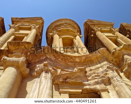 Ancient temple(Al Dayr) in Petra, Jordan.Ancient Nabataean city Petra,Jordan. Accessed by ascending 850 steps,the Monastery was originally dedicated to the Nabataean god Obodas in the 1st century BCE. - stock photo