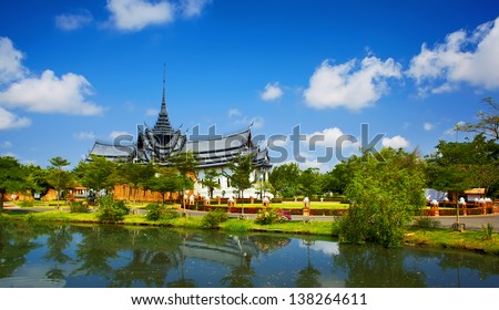 Ancient temple in Thailand in sunny day - stock photo