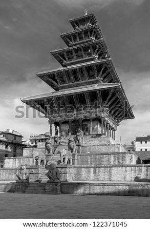 Ancient temple with the statues in the Bhaktapur - Nepal, Himalayas (black and white) - stock photo