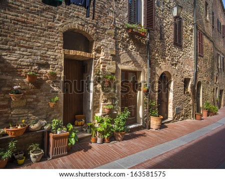 ancient 15th century housing in a small village in Tuscany - stock photo