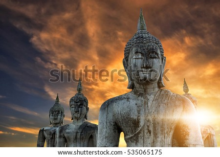 Ancient thai buddha statues with sunlight in the morning.