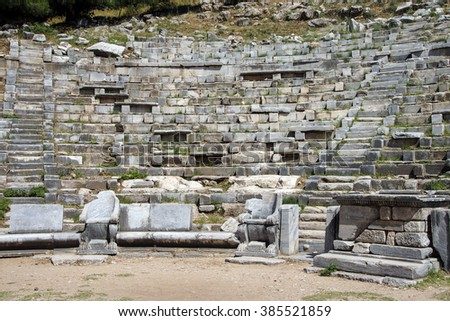 Ancient theatre with rows of stone seats,  Priene,  Turkey - stock photo