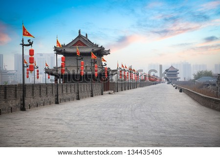 ancient tower at dusk in xian city wall ,China - stock photo