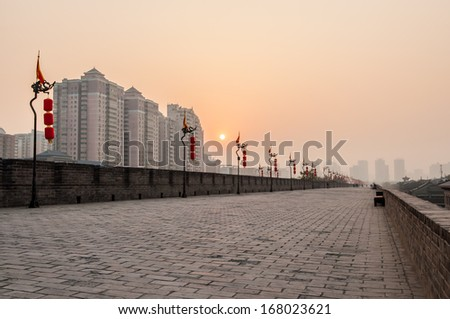 ancient tower at sunset in xian city wall ,China