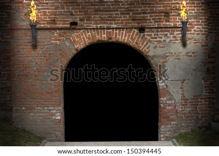 Ancient tower gate way highlighted by pair of iron torch and it have bricks in the wall. Clipping path included - stock photo