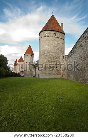 ancient towers and a city wall - stock photo