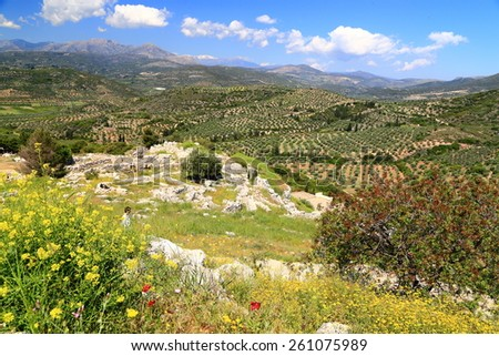 Ancient town of Mycenae surrounded by trees and vegetation on the hills of Peloponnese, Greece