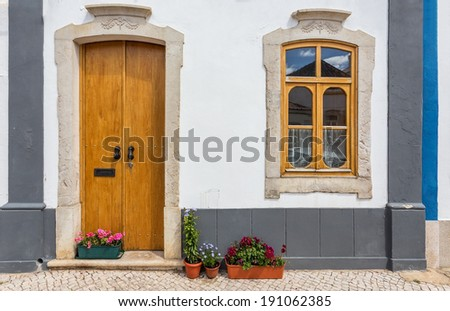 Ancient traditional Portuguese street view. Window, door vintage. - stock photo