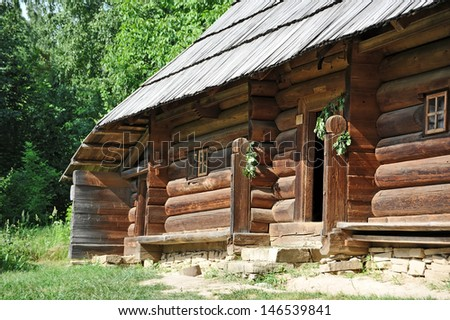 Ancient traditional ukrainian rural cottage with a straw roof - stock photo
