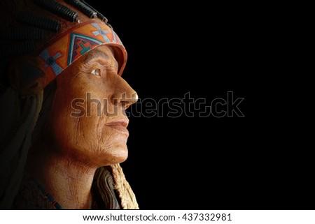 Ancient tribe statue Ancient tribe statue on black background. - stock photo