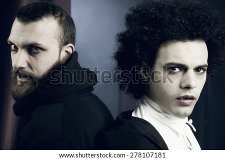 Ancient vampires serious showing fangs - stock photo
