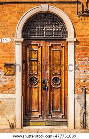 Ancient Venetian wooden door.